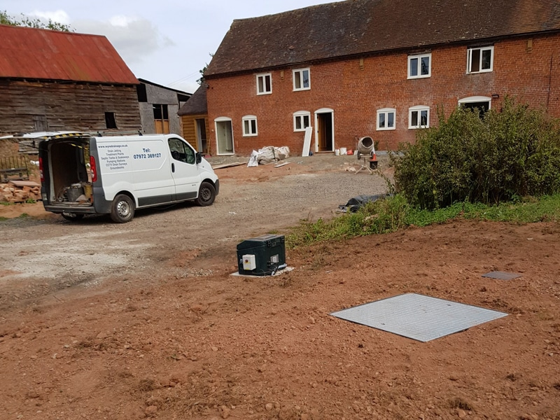 Wyre Drainage engineers on site completing an inspection cover installation for a sewage and waste water system