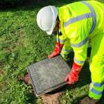 Drainage engineer removing inspection cover